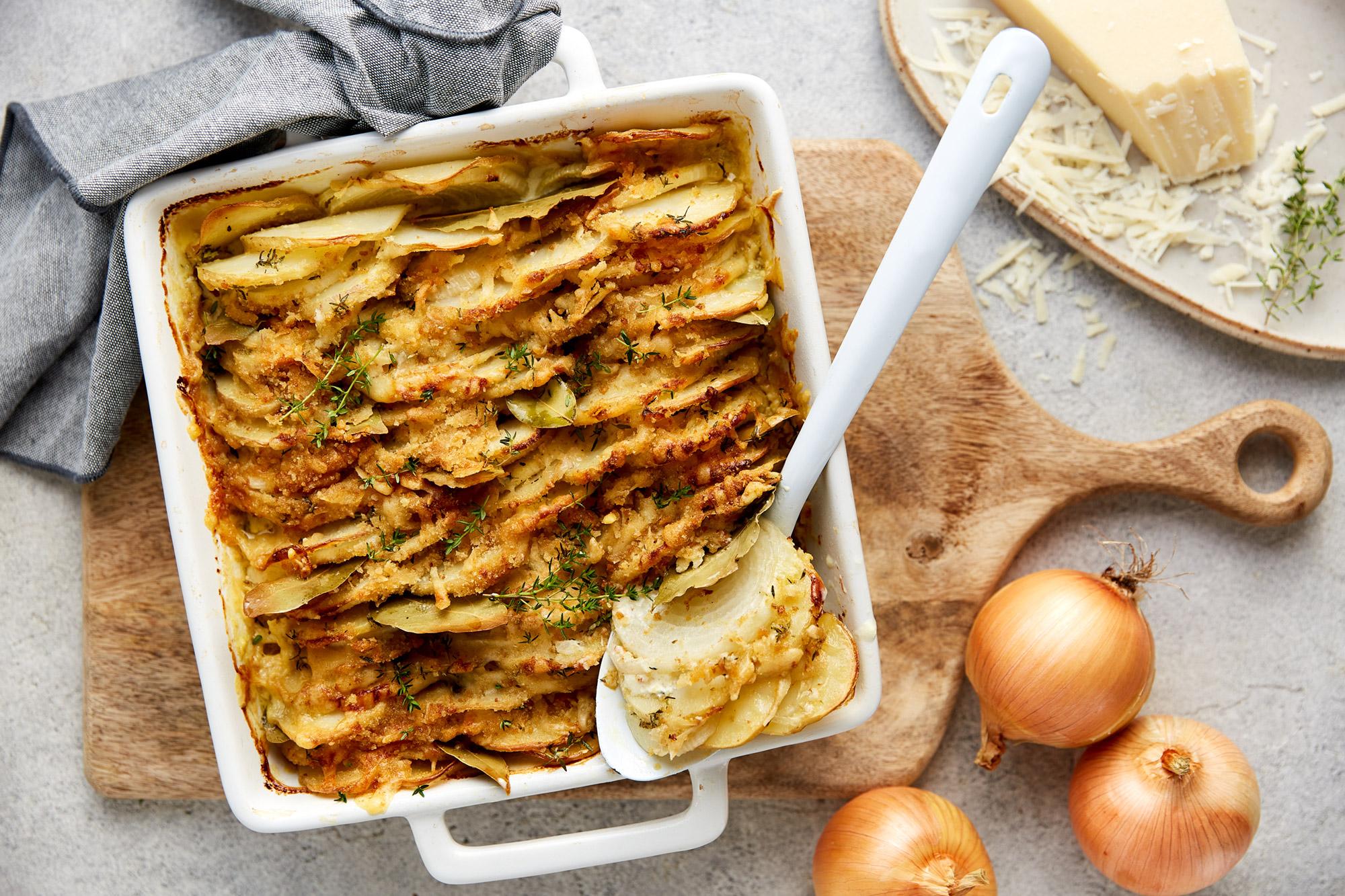 Cheesy onion and potato tray bake