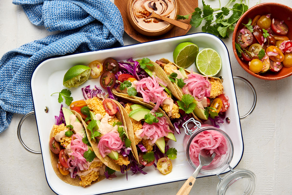 Cornflake crumb fish tacos with quick red onion pickle